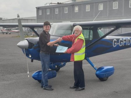 Members flying lessons earning solo flying certificate